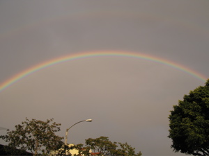 Image description: a double rainbow arcs over a Southern California urban landscape.